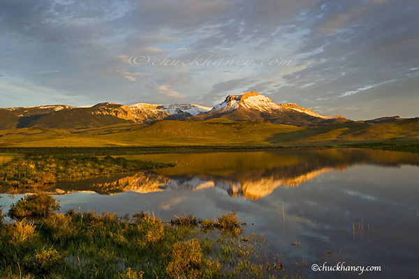 Ear Mountain reflcts into calm Lake Theboe along the Rocky Mountain Front in Montana