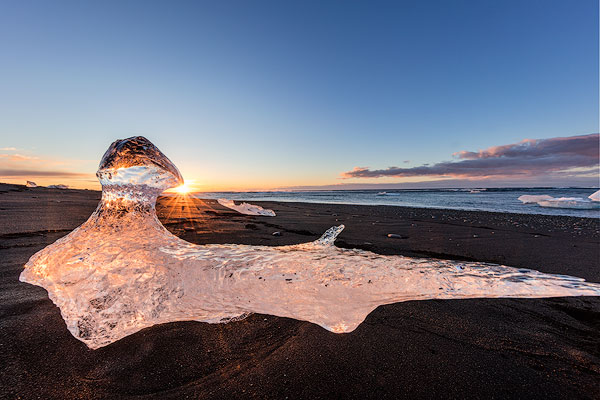 Scattered ice from icebergs on black sand beach at Joklusarlon, Iceland