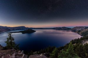 Night time stars over Crater Lake in Crater Lake National Park, Oregon, USA