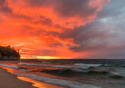 Dramatic sunset light light along Miners Beach in Pictured Rocks National Lakeshore, Michigan, USA