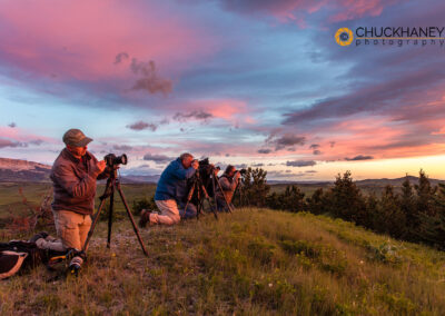 Photographers capture the sunrise near Dupuyer, Montana, USA
